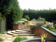 steps in low maintenance garden